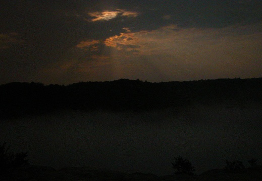 Moonrise over Big South Fork in fog.